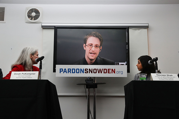 Edward Snowden speaks via video link at a news conference for the launch of a campaign calling for President Obama to pardon him on September 14.