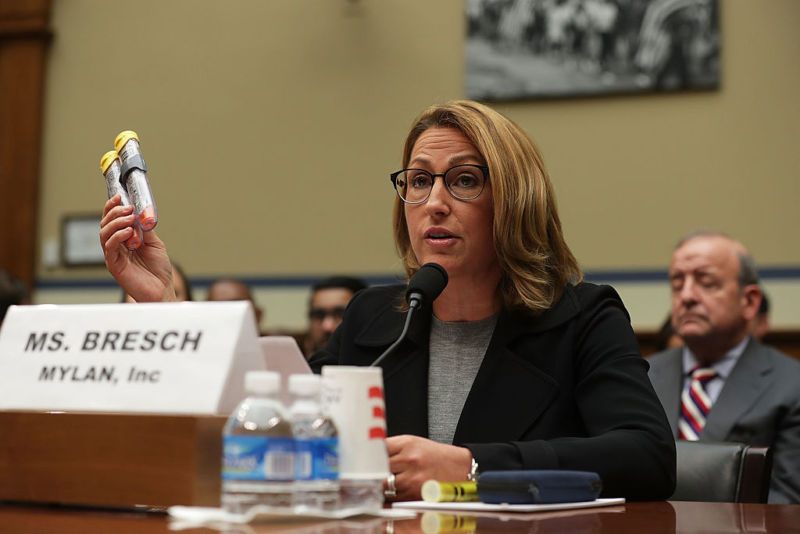 "WASHINGTON, DC - SEPTEMBER 21:  Mylan Inc. CEO Heather Bresch holds up a 2-pack of EpiPen as she testifies during a hearing before the House Oversight and Government Reform Committee September 21, 2016 on Capitol Hill in Washington, DC. The committee held a hearing on ""Reviewing the Rising Price of EpiPens.""  (Photo by Alex Wong/Getty Images)"