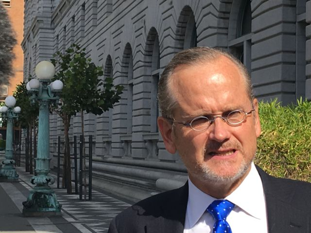 Larry Lessig spoke with reporters after the 9th Circuit hearing.