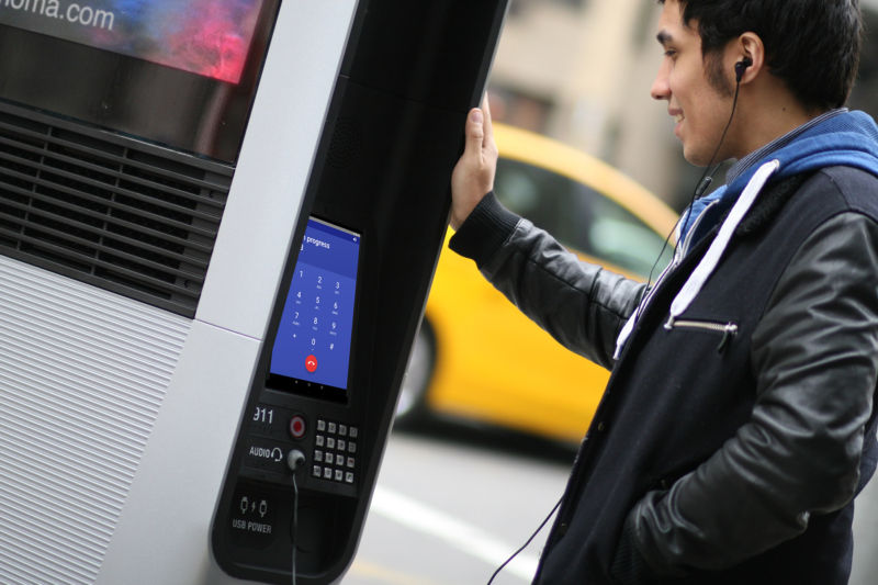 A LinkNYC user making a phone call on the kiosk's tablet.