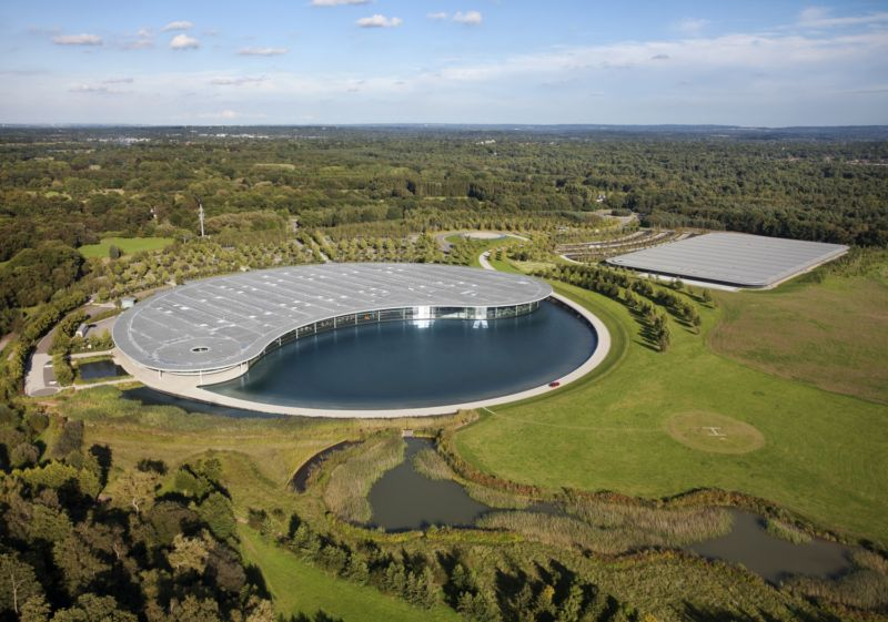 McLaren's HQ in Woking, England. That lake provides water used to cool the wind tunnel. The round building next to the lake is where the F1 team is based; the one to the right is the production center where the company builds road cars.
