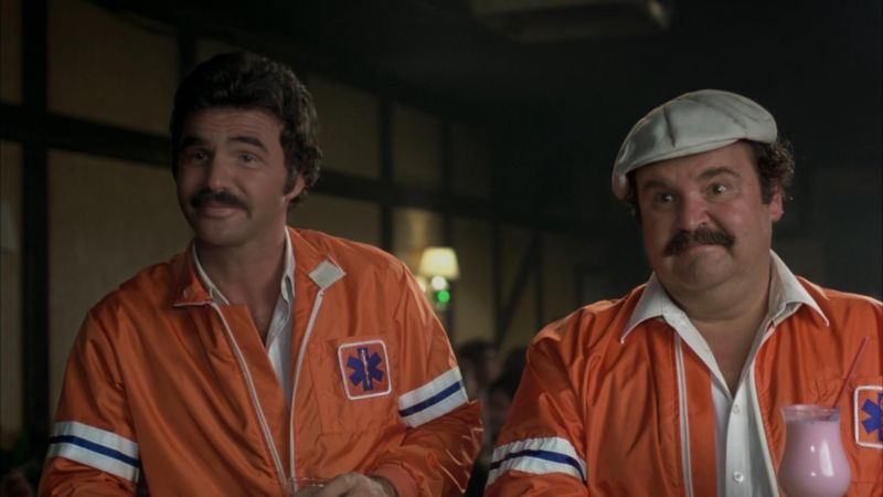 Burt Reynolds as JJ McLure, and Dom DeLuise as Victor Prinzim in <em>The Cannonball Run</em>. Alex Roy is neither of these two characters. But it did give our office a chance to reminisce over how much we all loved the movie.