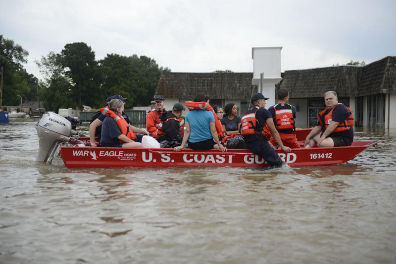 A Coast Guard boat carries several Baton Rouge residents to safety.