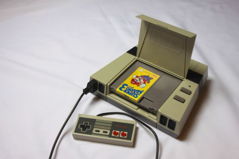 With the dust cover open, you can at least see what cartridge you're playing. Inserting and removing those cartridges is a pain, though.