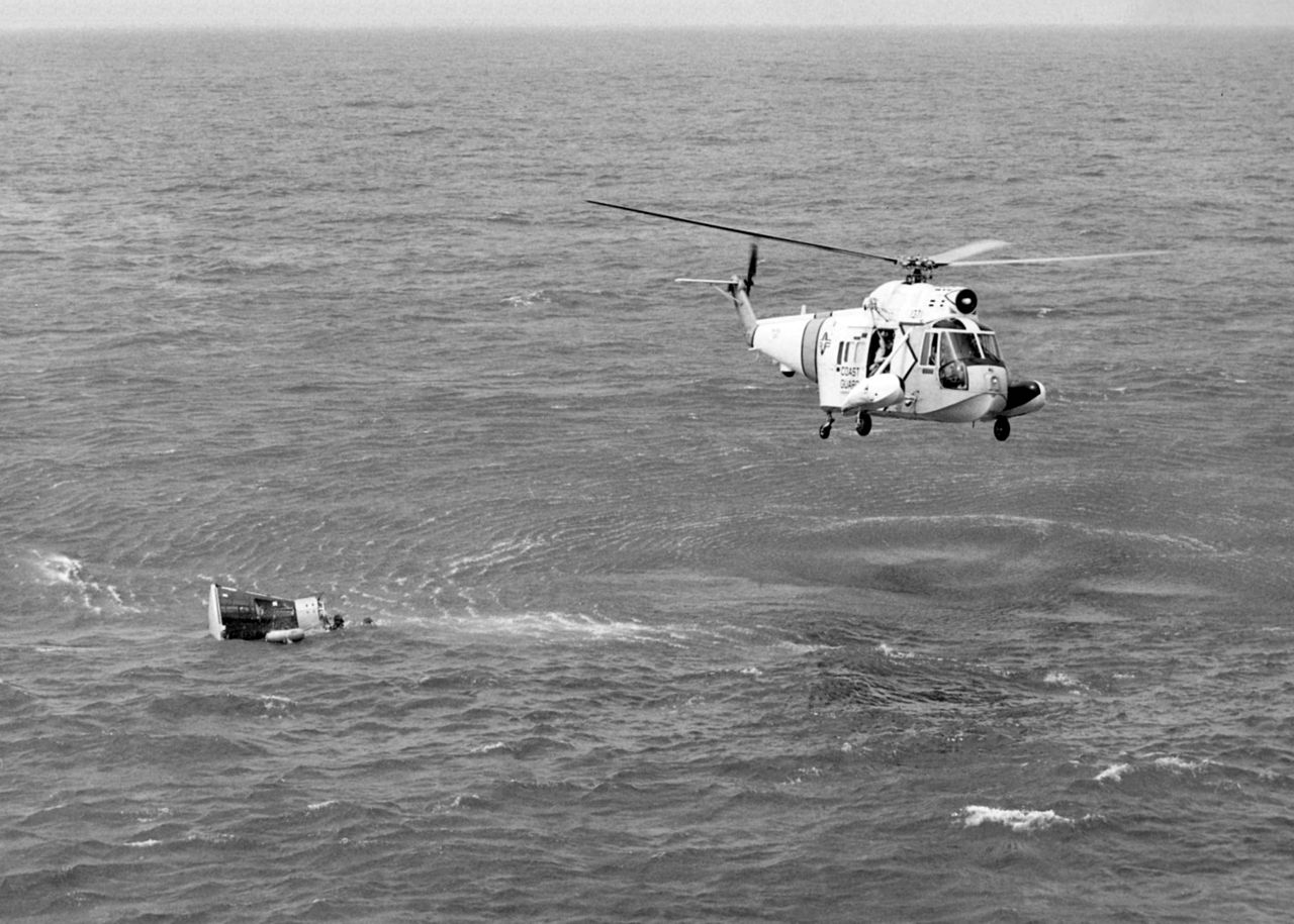 A US Coast Guard Sikorsky Seaguard helicopter flies over the Gemini 3 space capsule flown by astronauts Gus Grissom and John Young after it splashed down in the Atlantic Ocean in 1965.