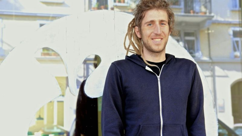 Man with wild hair and a hoodie.