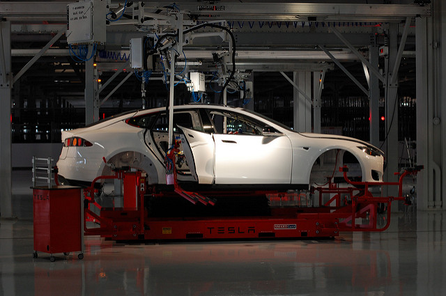 A car is worked on at the Tesla Factory in Fremont, CA.