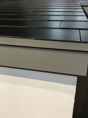 An image of real demo tiles at Tesla's November press announcement. These tiles are transparent from the top but opaque at an angle.