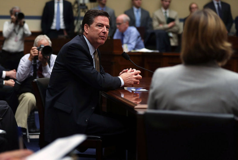 "WASHINGTON, DC - JULY 07:  FBI Director James Comey testifies during a hearing before House Oversight and Government Reform Committee July 7, 2016 on Capitol Hill in Washington, DC. The committee held a hearing ""Oversight of the State Department,"" focusing on the FBI's recommendation not to prosecute Democratic presidential candidate Hillary Clinton for maintaining a private e-mail server during her time as secretary of state."