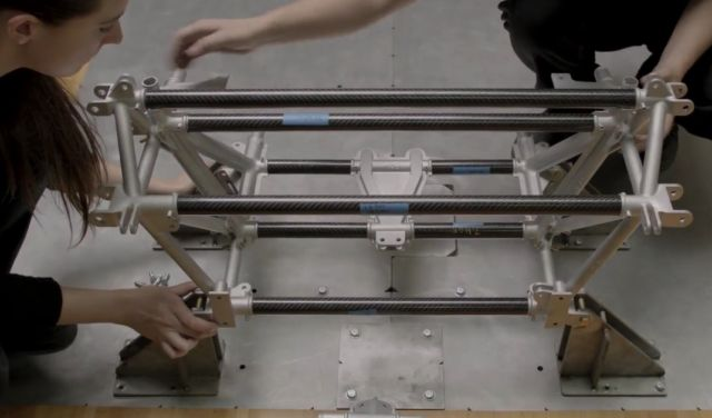 3D-printed metal nodes and laser-cut carbon fiber tubes are used to rapidly assemble a prototype lightweight chassis frame.