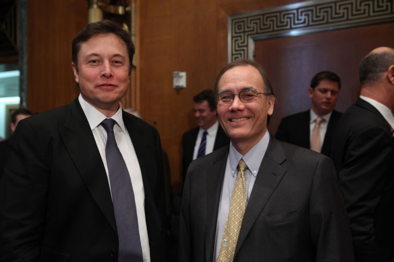 Elon Musk of SpaceX, left, and Scott Pace, right, of George Washington University, testify before the Senate Subcommittee on Defense under the Committee on Appropriations in 2014.