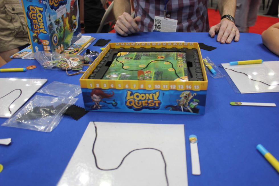 In <em>Loony Quest</em>, players have to trace their way through an obstacle course to get points. But they have to do so on an off-board transparent sheet of plastic.