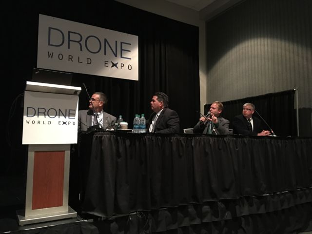 Cmdr. Tom Madigan (second from right) spoke at the conference on Tuesday.
