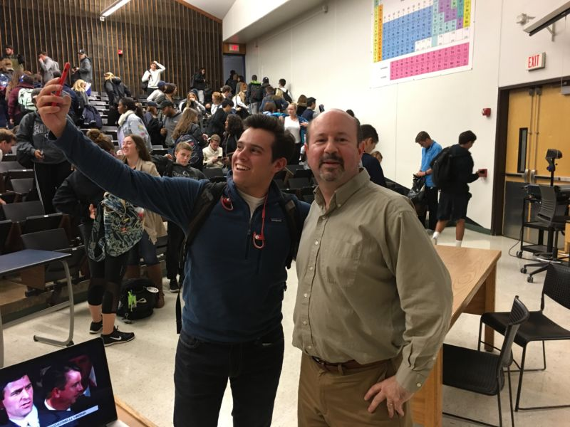 Mike Mann of Penn State poses for a selfie with a fan.