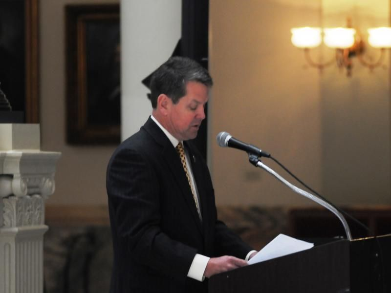 Georgia politician Brian Kemp reads at a Holocaust remembrance ceremony in the state.