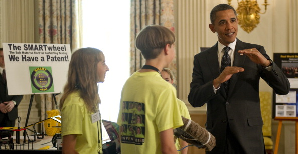 President Obama has been a supporter of anti-texting and driving measures. Pictured: In 2010, he invited students to a White House science fair and honored the kids behind a devicethat sends out an alarm when you take a hand off the steering wheel for more than three seconds.