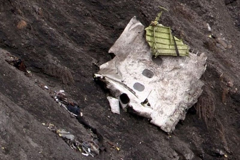 A screen grab taken from an AFP TV video on March 24, 2015 shows debris of the Germanwings Airbus A320 at the crash site in the French Alps above the southeastern town of Seyne. The plane, which had taken off from Barcelona in Spain and was headed for Dusseldorf in Germany, crashed earlier in the day with 150 people onboard.