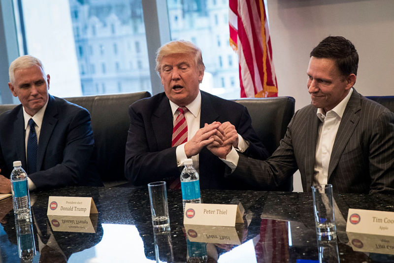 Vice President-elect Mike Pence looks on as President-elect Donald Trump shakes the hand of Peter Thiel during a meeting with technology executives at Trump Tower, December 14, 2016 in New York City.