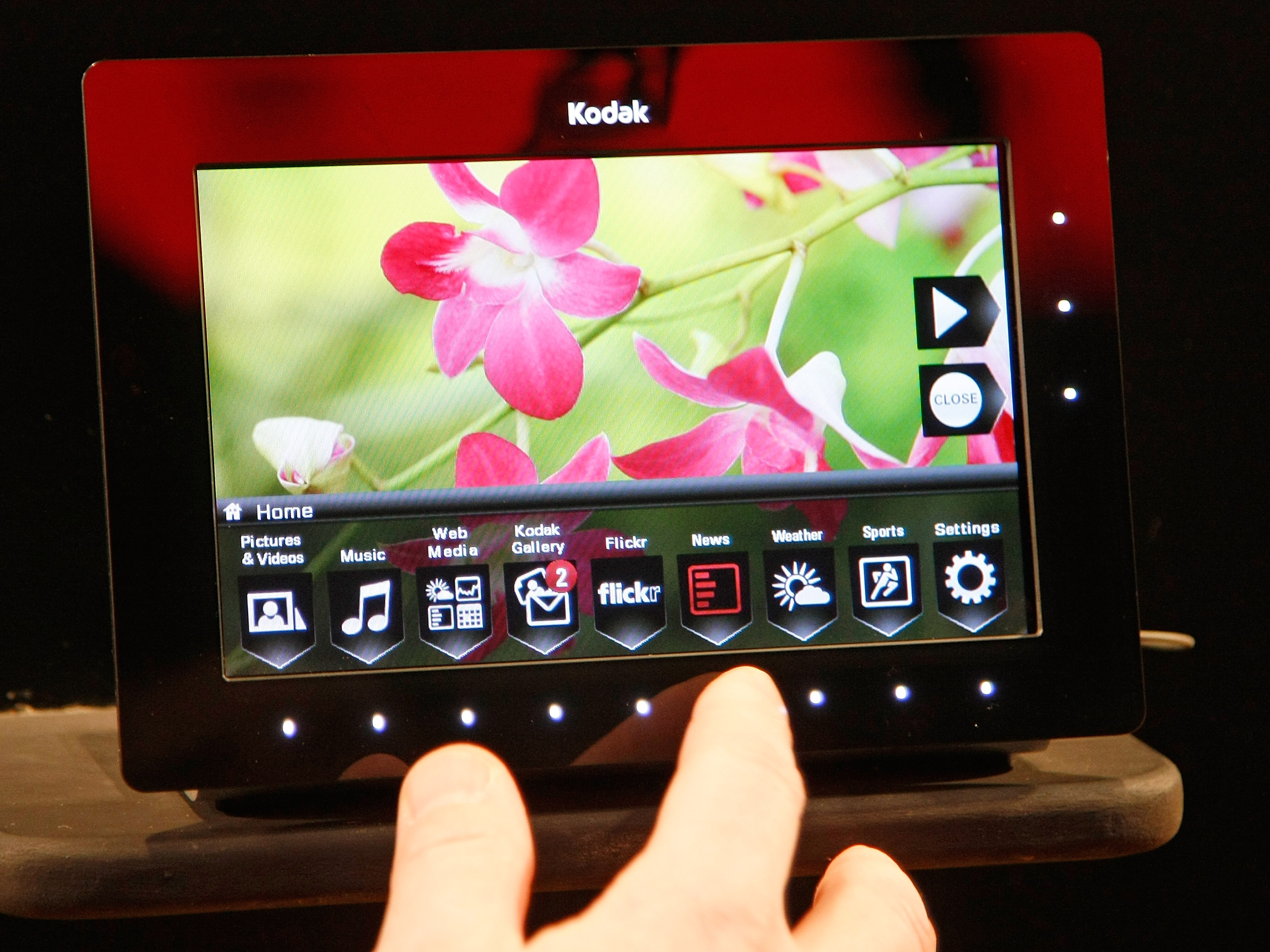 Kodak's work on OLED technology didn't manifest into many consumer-grade products. Here, Kodak shows off an OLED digital photo frame at CES 2009, months before selling its OLED R&D portfolio to LG.