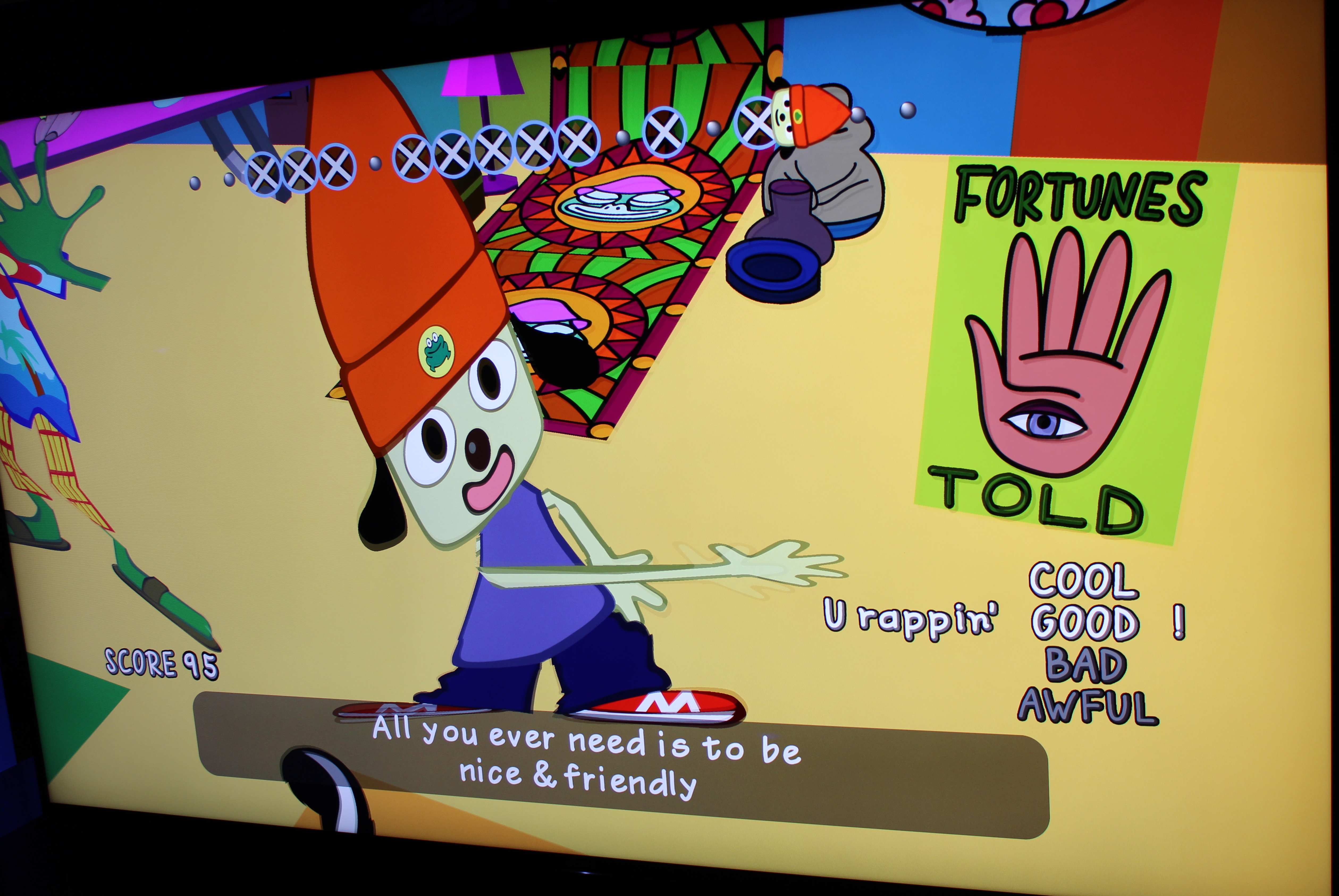 An off-screen photo of a 4K display, which isn't perfect, but it does show how <em>Parappa</em>'s remaster can look a little funky. Weird limb effects that were blurred and grainy in the original are made much more apparent in 4K.