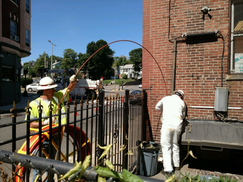 Verizon workers lay fiber underground in the Boston neighborhood of Roxbury.