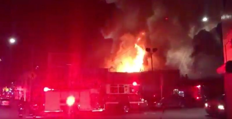 The fire at the 1300 block of 31st Ave., Oakland, California, as seen late Friday evening and into the early hours of Saturday.