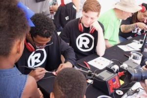 Nick Cannon getting his soldering skills on at a Radio Shack station at the National Maker Faire.