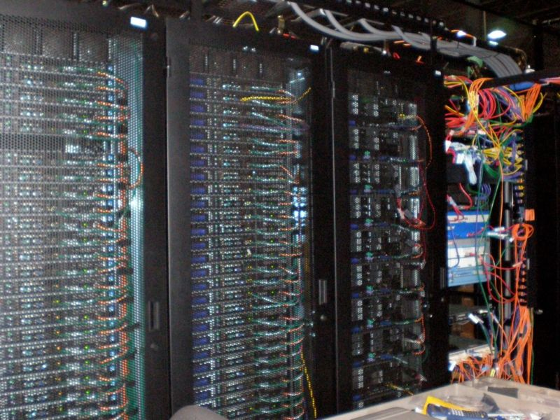 Datacenters are mostly filled with racks of computers and network cables.