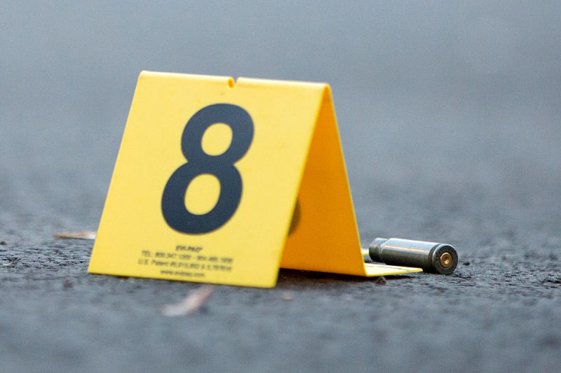 An evidence marker sits next to a rifle casing at the scene of a fatal shooting in the 4500 block of South Hermitage Avenue Monday, Labor Day, September 5, 2016, in the Back of the Yards neighborhood of Chicago.