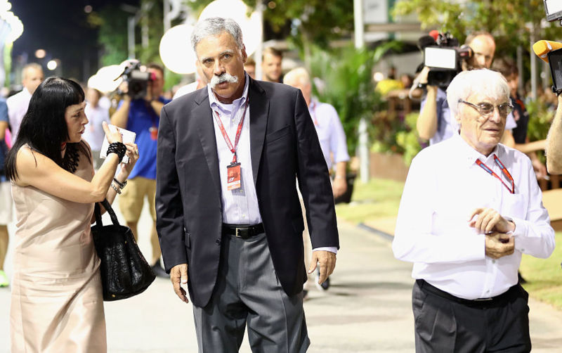 Chase Carey (center) is the new CEO of Formula 1. Bernie Ecclestone (right) made the sport what it is today, but he's in charge no more.