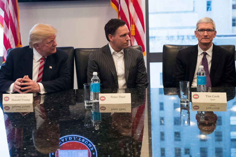 Tim Cook (right) looks engaged and enthusiastic sitting next to President-elect Donald Trump and Peter Thiel at Trump's tech summit in New York City last month.