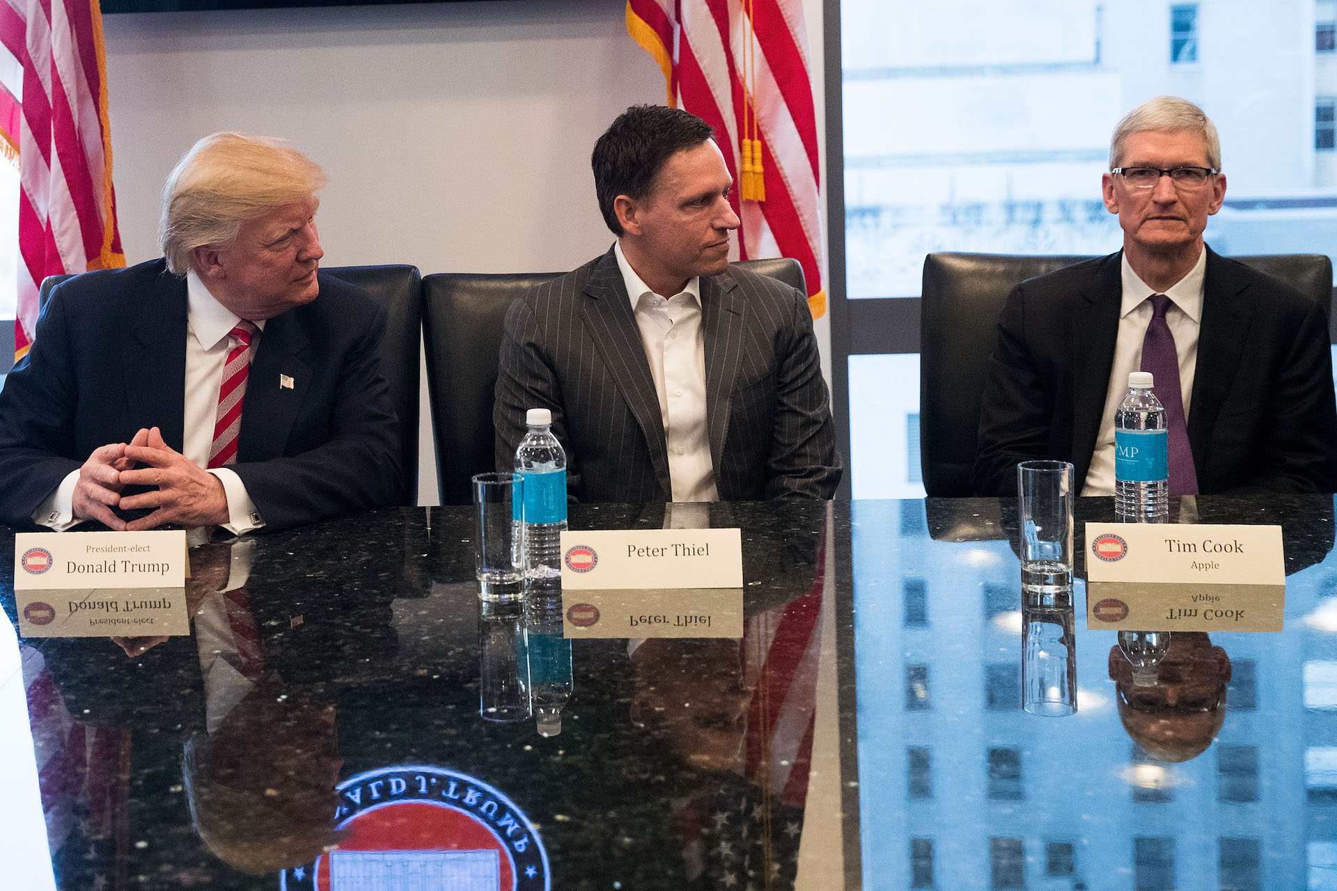 enlarge tim cook right looks engaged and enthusiastic sitting next to president elect donald trump and peter thiel at trumps tech summit in new york