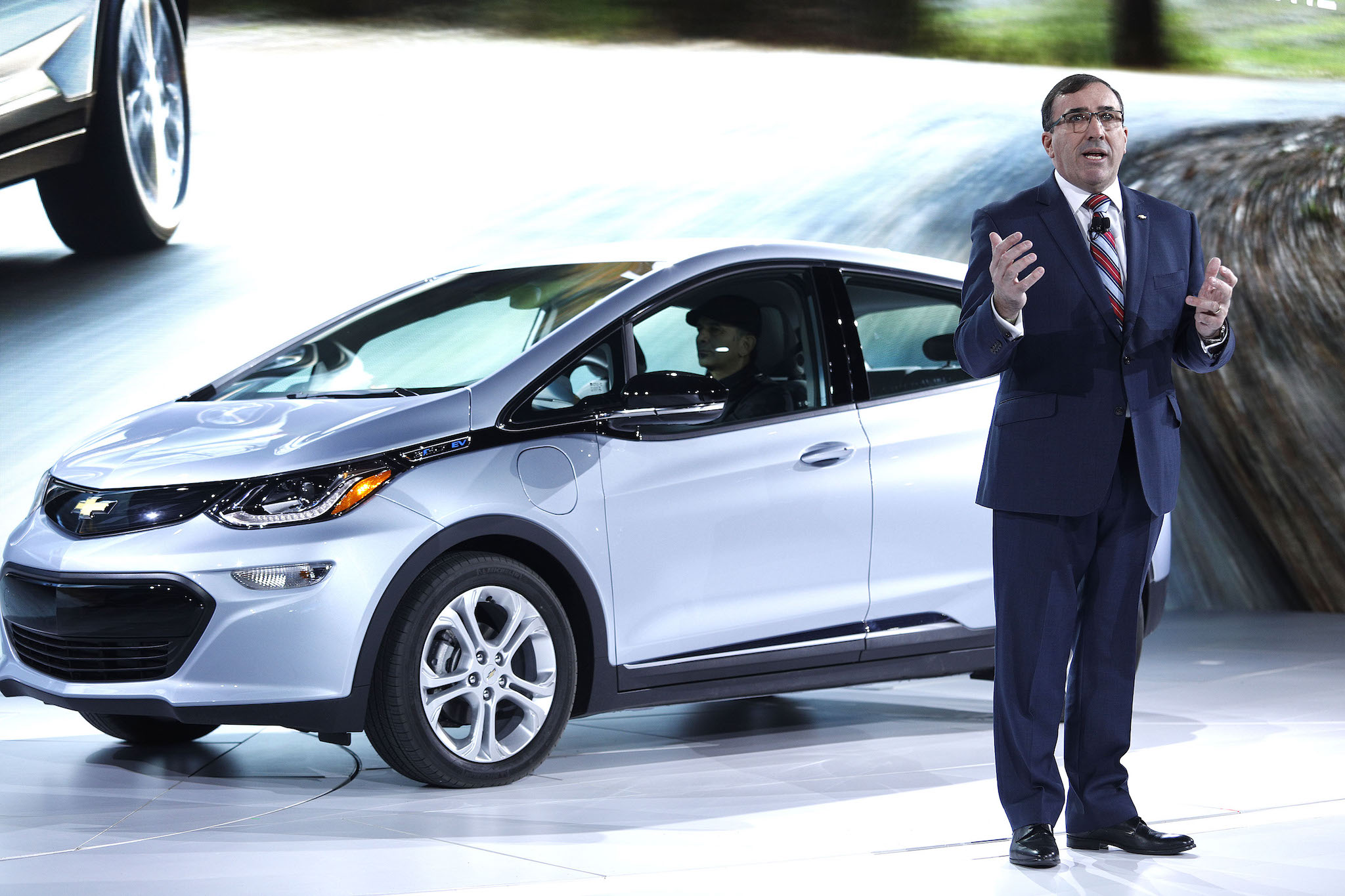 Alan Batey, General Motors president of North America, on stage with the Chevrolet Bolt at NAIAS.