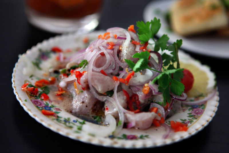 Ceviche, as pictured here, is a dish served in many parts of Latin America. It's made of raw fish cured in citrus juices.