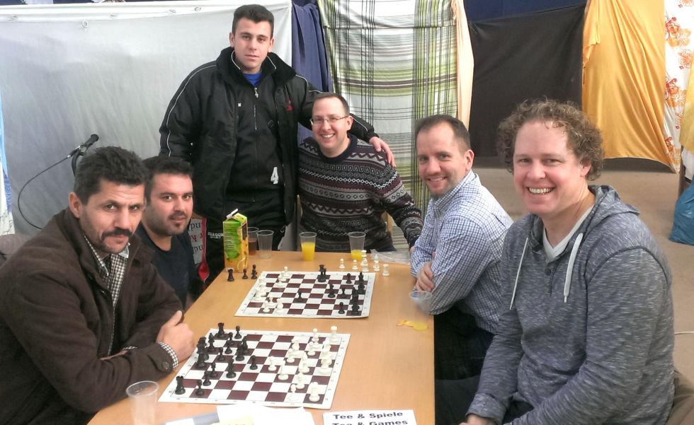 Playing chess inside one of the Berlin refugee shelters.