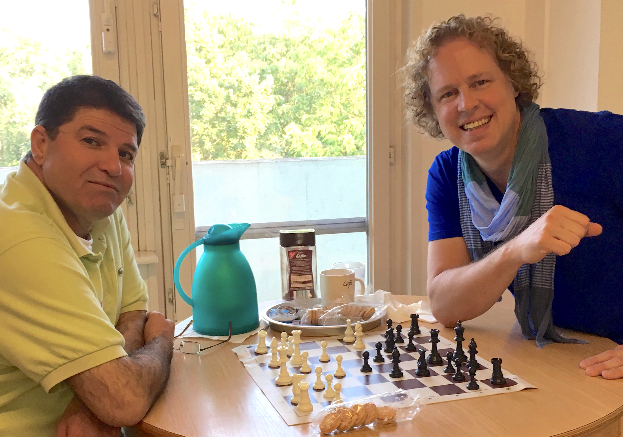Allers (right) and a new friend playing chess in Berlin.