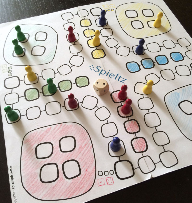 An individual <em>Parcheesi</em> board colored by one of the children.