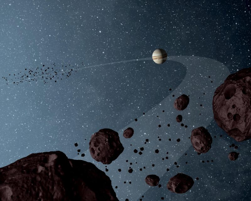 NASA has selected two new missions to explore asteroids, including the Trojan asteroids in Jupiter's orbit depicted in this artist's concept (not at all to scale).