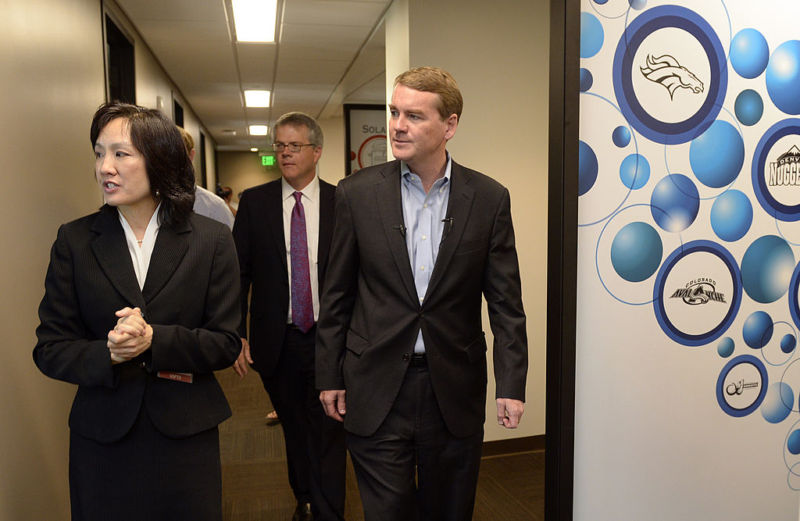 USPTO Deputy Director Michelle K. Lee, left, tours the Denver satellite office of the US Patent and Trademark Office in 2014. US Senator Michael Bennet of Colorado is on the right.