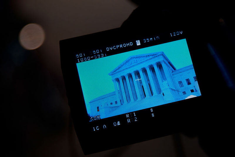 The Supreme Court Building in Washington, DC, is displayed on a camera monitor outside the building on January 31, 2017.