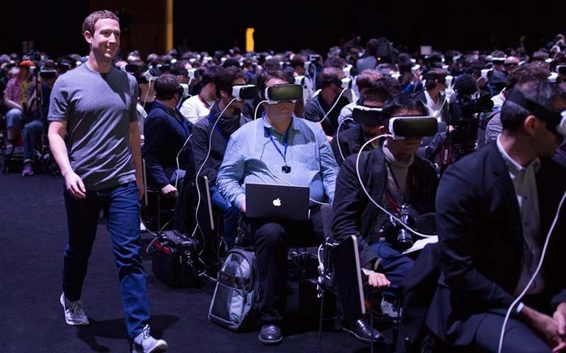 Facebook CEO Mark Zuckerberg wanders past oblivious people in Samsung Gear VR headsets in a photo that is not from this trial.