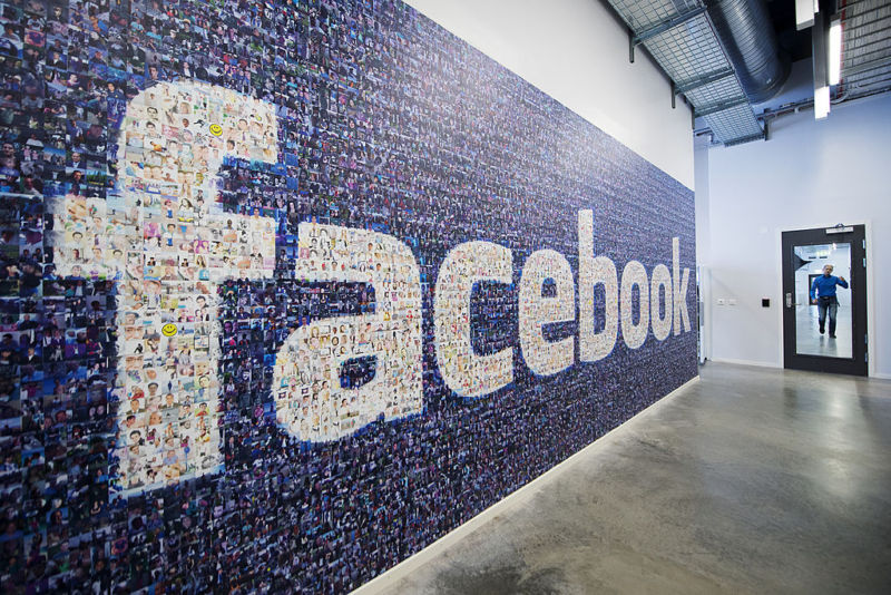 A wall of user photos form a Facebook logo at the company's data center in Lulea, Sweden.