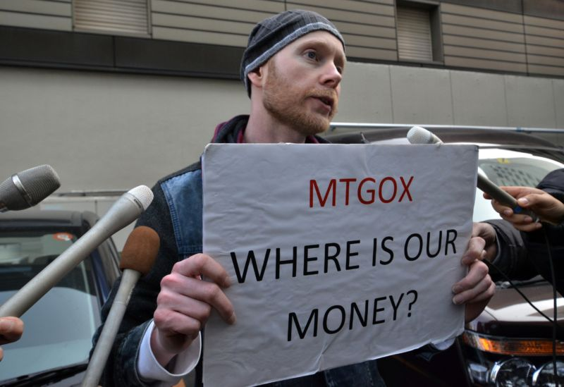 Bitcoin trader Kolin Burges from London speaks to reporters as he protests against Tokyo-based bitcoin changer Mt. Gox in front of the company's office in Tokyo on February 26, 2014.