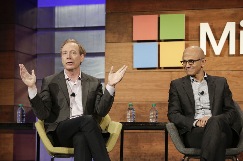 Brad Smith, Microsoft's top lawyer (left), seen here speaking with CEO Satya Nadella on November 30, 2016.