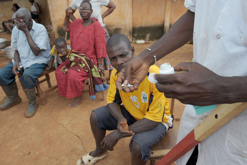 A nurse distributes medicine, ivermectin, against onchocerciasis or river blindness, caused by a parasitic worm and spread by the bite of an infected blackfly.