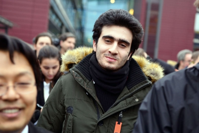 Anas Modamani outside court today in Wurzburg, Germany.