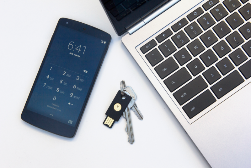 The Yubikey Neo (the black USB key) is a FIDO U2F-compliant key that works over NFC or USB.