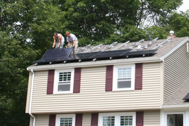 Solar panels being installed in Massachusetts.