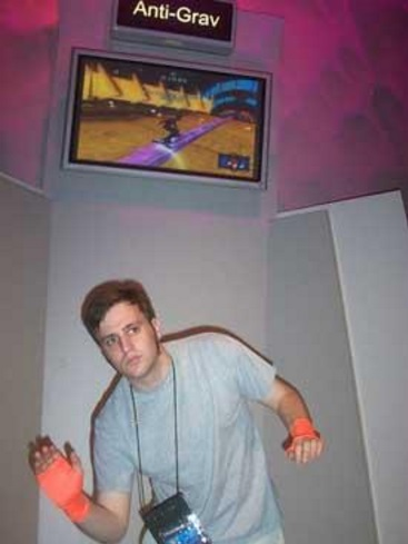 Trying out Harmonix's <i>EyeToy Anti-Grav</i> at my first ever E3 in 2004. The gloves let the PS2 camera see your hands accurately, and made for a great fashion statement!