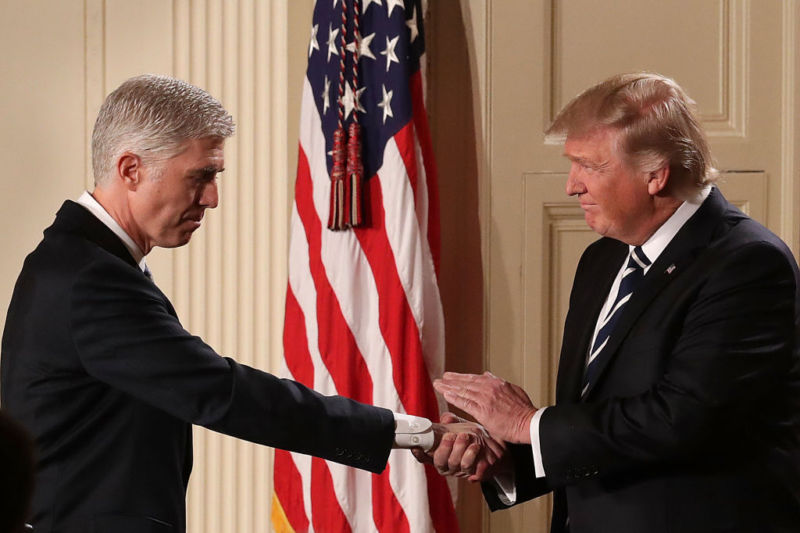 President Donald Trump shakes hands with Judge Neil Gorsuch after nominating him to the Supreme Court during a ceremony in the East Room of the White House on Tuesday. If confirmed, Gorsuch would fill the seat left vacant with the death of Justice Antonin Scalia in February 2016.